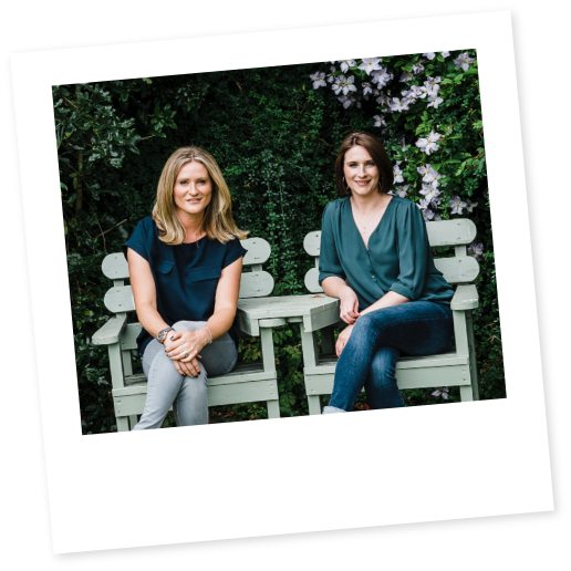 Stacy and Jennifer the founders of Myrror sitting on a garden chair