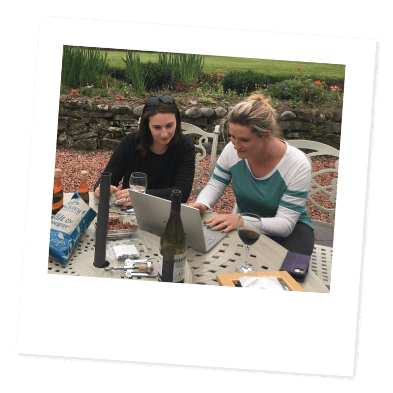 Stacy and Jennifer working outside on a garden table